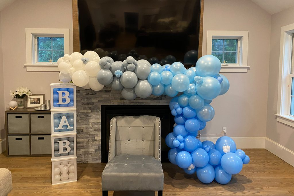 Baby Blocks Next To Balloons and Chair