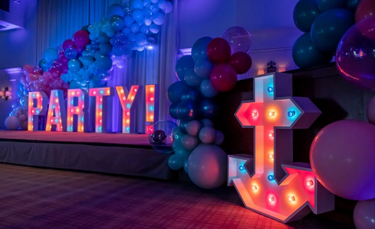 Elevated Impressions Party With Glowing Signs